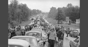 Hundreds of rock music fans jam highway leading from Bethel, New York, Aug. 16, 1969 as they try to leave the Woodstock Music and Art Festival. Two hundred thousand persons spent a rainy night at the festival. (AP Photo)