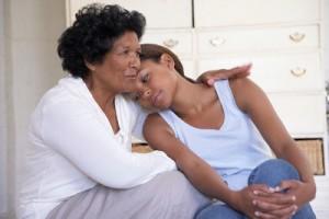 Grandmother comforting granddaughter --- Image by © Tomas Rodriguez/Corbis