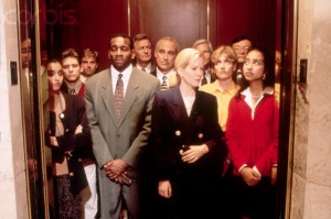 --- Executives crowded into elevator --- Image by © Chuck Savage/Corbis