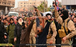Images proport to show two men being crucified in Raqqa on Friday 16th January. Images sourced from twitter / online - http://justpaste.it/7dod Brutal killings in Syria, captioned as scenes from Raqqa & Nineveh.11.jpg