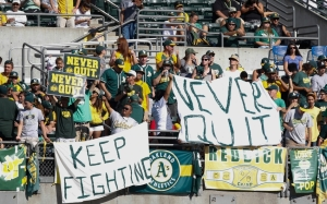 Sep 20, 2014; Oakland, CA, USA; Oakland Athletics fans hold signs during the ninth inning against the Philadelphia Phillies at O.co Coliseum. The Philadelphia Phillies defeated the Oakland Athletics 3-0. Mandatory Credit: Kelley L Cox-USA TODAY Sports