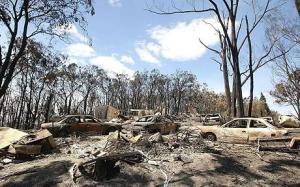 Death Toll Passes 100 As Bushfires Sweep Through Victoria...CHRISTMAS HILLS, AUSTRALIA - FEBRUARY 09:   Burnt out carsare seen following the bushfires that swept through the region on February 9, 2009 in Christmas Hills, Australia. Victoria Police have revised the bushfire disaster death toll to 131, the worst in Australia's history. (Photo by Lucas Dawson/Getty Images)