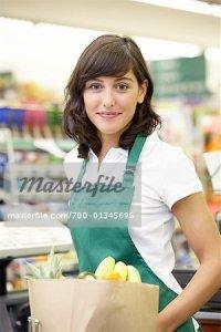 700-01345695 © Noel Hendrickson Model Release: Yes Property Release: Yes Model & Property Release Portrait of Supermarket Cashier