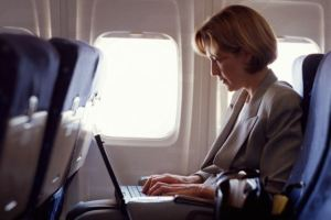 dvt getty woman on plane with laptop
