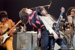 Keith Richards leaning on Mick Jagger of The Rolling Stones on stage at MSG, NYC. June 22, 1975. © Bob Gruen / www.bobgruen.com Please contact Bob Gruen's studio to purchase a print or license this photo. email: websitemail01@aol.com phone: 212-691-0391