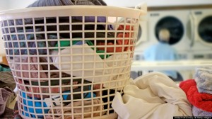 Basket filled with laundry in laundromat