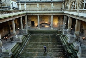 BATH, UNITED KINGDOM - NOVEMBER 13: Bath and North East Somerset Council employee Phil Grant brushes the last of the algae and sludge from the original Roman lead lined floor of the Great Bath as it is drained of natural thermae spa water as part of a cleaning operation, at the historic Roman Baths on November 13 2008 in Bath, England. Sited below modern street level the Roman Baths contains one of the best examples of a preserved Roman bath complex in Europe. Previous cleaning operations have revealed all manners of modern day debris including traffic cones, shopping trolleys and even a moped. Accidently re-discovered in the 1800s, the steps and lead lining of the Great Bath are over 2000 years old and are visited by over one million tourists a year. (Photo by Matt Cardy/Getty Images)