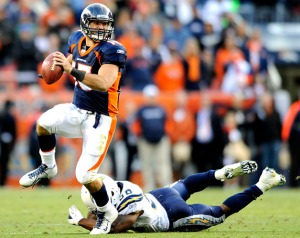 Denver Broncos quarterback Tim Tebow (15) scrambles away from San Diego Chargers inside linebacker Donald Butler (56) in the fourth quarter during an NFL football game, Sunday, Oct. 9, 2011, in Denver. San Diego won 29-24. (AP Photo/Jack Dempsey)