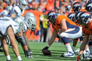Denver Broncos center J.D. Walton (50) prepares to snap the ball during second quarter action against the Oakland Raiders in the NFL game at Sports Authority Field in Denver, CO September 30, 2012. (AP Photo/ Eric Bakke )