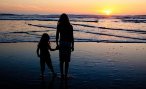 two sisters during photo sesssion at ocean beach, San francisco during sunset