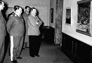 ca. 1930s, probably Berlin, Germany --- Hermann Goering and Adolph Hitler examine a painting at what is probably the exhibit