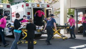 A patient is wheeled into the Emergency Room at Mercy Medical Center. Mercy was under extreme stress dealing with victims from the shooting at Umpqua Community College and regular patient admittances. (AARON YOST/THE NEWS-REVIEW)