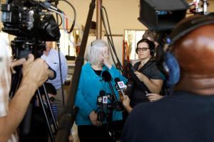Umpqua Community College interim president Rita Cavin pauses as she speaks to the media after a mass shooting at Umpqua Community College in Roseburg, Oregon October 1, 2015. A gunman opened fire at a community college in southern Oregon on Thursday, killing 13 people and wounding some 20 others before he was shot to death by police, state and county officials said, in the latest mass killing to rock a U.S. school. There were conflicting reports on the number of dead and wounded in the shooting rampage in Roseburg, which began shortly after 10:30 a.m. local time (1730 GMT). REUTERS/Steve Dipaola - RTS2O6B