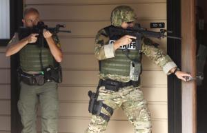 Authorities respond to a report of a shooting at Umpqua Community College in Roseburg, Ore., Thursday, Oct. 1, 2015. (Michael Sullivan /The News-Review via AP) MANDATORY CREDIT