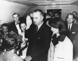 Flanked by Jackie Kennedy (right) and his wife Lady Bird Johnson (second left), U.S Vice President Lyndon Johnson (center) is administred the oath of office by Federal Judge Sarah T. Hughes (left) as he assumed the presidency following the assassination of President John F. Kennedy in Dallas, Texas, November 22, 1963. (Photo by CECIL STOUGHTON/AFP/Getty Images)