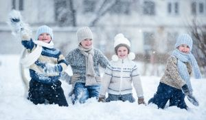 Children playing in the snow on a winter day