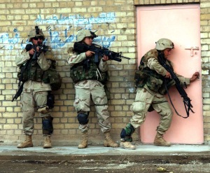 Soldiers from 1st Platoon, Apache Troop, 2-5 Cav, 2nd BCT, 1st Cav Div move tactically as they enter and clear their objective during combat operation in Fallujah on the 9th of Nov 2004 during Operation Iraqi Freedom. Photo by SFC Johancharles Van Boers, 55th Signal Company, Combat Camera, Fort Meade, Maryland. Release for Public Use
