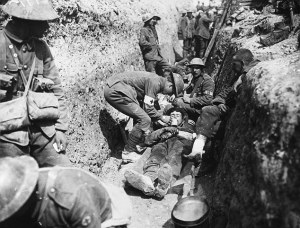 Wounded British soldiers are attended to in a trench during the first day of the Battle of the Somme Date: 1 July 1916