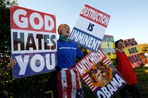 Members of the Westboro Baptist Church hold anti-gay signs at Arlington National Cemetery in Virginia on Veterans Day, November 11, 2010.  REUTERS/Kevin Lamarque (UNITED STATES - Tags: POLITICS)