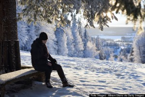 Sweden, Jamtland, Froson, Man looking at winter forest