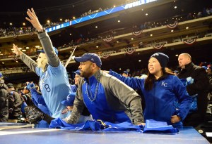 Oct 31, 2015; New York City, NY, USA; Fans of the Kansas City Royals cheer during game four of the World Series against the New York Mets at Citi Field. Mandatory Credit: Jeff Curry-USA TODAY Sports