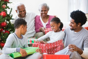 Family opening presents on Christmas morning --- Image by © JLP/Jose L. Pelaez/Corbis