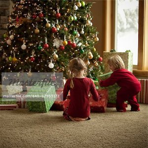 640-02953172 © Masterfile Royalty Free Model Release: Yes Property Release: No two children opening gifts on christmas morning