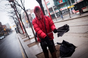 TORONTO, ON- APRIL 9 -   A woman tosses a broken umbrella back to the ground in Chinatown, April 9, 2015  Melissa Renwick/Toronto Star Melissa Renwick/Toronto Star