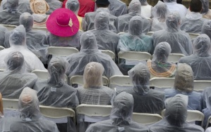 "Guests wear ponchos in the rain during the Let Freedom Ring Commemoration and Call to Action to commemorate the 50th anniversary of the March on Washington for Jobs and Freedom at the Lincoln Memorial in Washington, DC on August 28, 2013. Thousands will gather on the mall on the anniversary of the march and Dr. Martin Luther King, Jr.'s famous ""I Have a Dream"" speech. TOPSHOTS/AFP PHOTO / Saul LOEBSAUL LOEB/AFP/Getty Images"