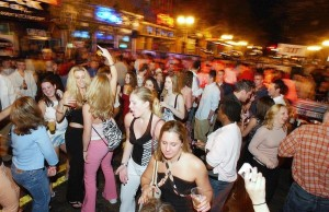 New Year's Eve revelers party in downtown Orlando on the evening of Wednesday, December 31, 2003. Street party at Church Street. (Orlando Sentinel/Ricardo Ramirez Buxeda) ORG XMIT: 14376